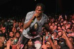 Picture of Travis Scott Kicks DJ off Stage During NYE Bash and Starts Mixing Himself