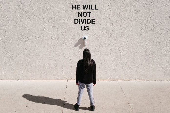 Shia LaBeouf Moves Controversial 'HE WILL NOT DIVIDE US' Installation to the UK