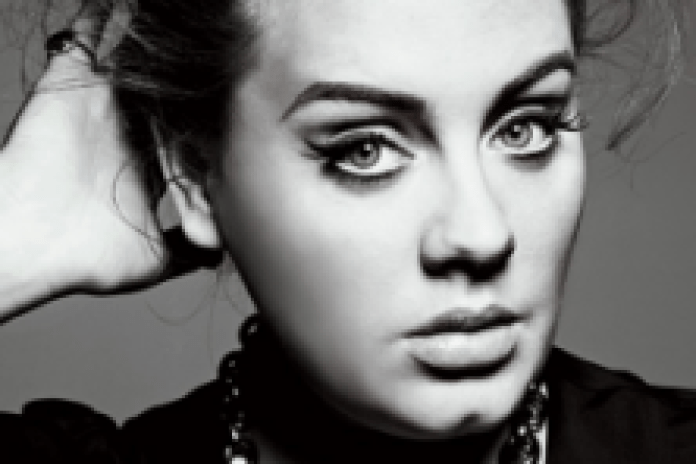 Adele recovering well after throat surgery