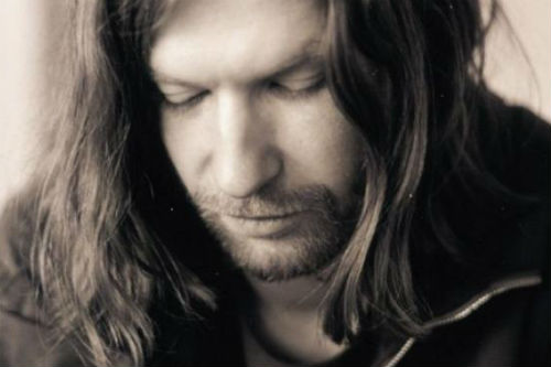 Aphex Twin conducts a 48-piece orchestra by remote control