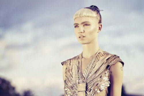 "Grimes signs to 4AD, releases new track ""Genesis"""