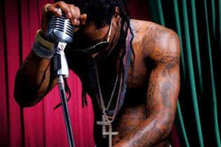 "Lil Wayne settles $1.5 million lawsuit over ""Love Me or Hate Me'"""