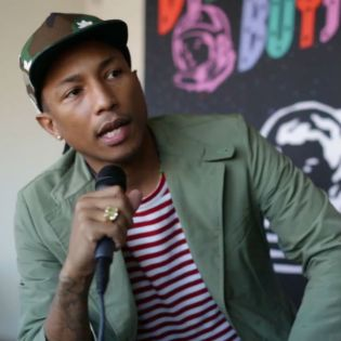 Pharrell Does 2 Chainz Impression While Speaking on 'Feds Watching' Production