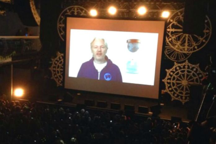 Julian Assange Opens for M.I.A. in New York via Skype