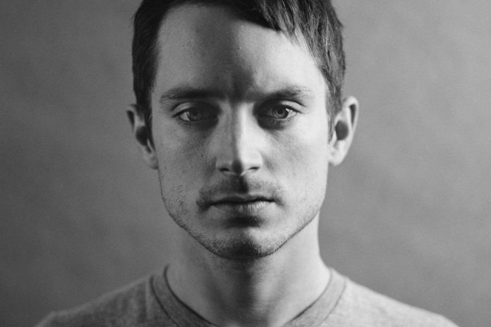 "Elijah Wood Curates ""Africa in Your Earbuds"" Playlist for Questlove's Okayafrica"