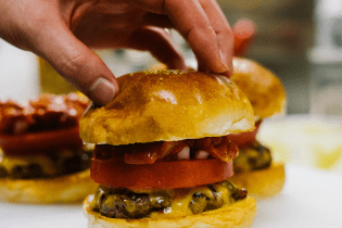 "Pharrell Williams Debuts His ""Pharrell Burger"" in Japan"