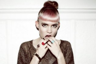 "Grimes Starts Over On New Album Due to Negative Response to ""Go"""