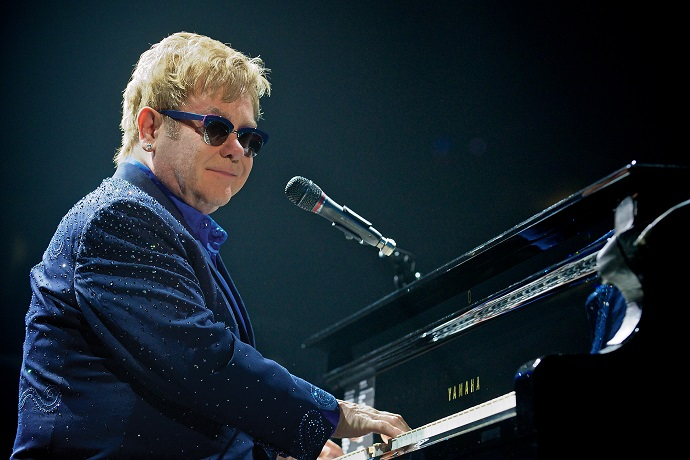 "Elton John ""Loves All"" of Young Thug's Outfits"