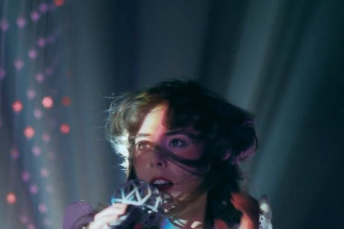 "Purity Ring Perform in a Cave Full of Lights for ""heartsigh"" Visual"