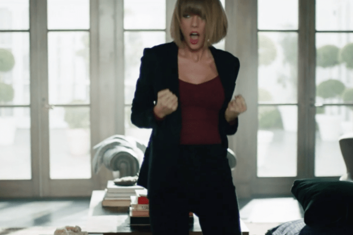"Watch Taylor Swift Lip-Synch The Darkness' ""I Believe in a Thing Called Love"""