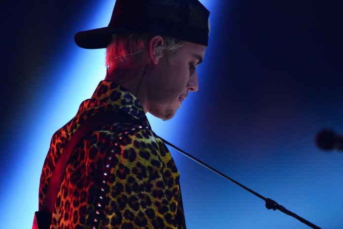 Justin Bieber Rejects Gift Fan Throws on Stage