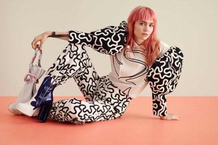 "Grimes Shares ""Medieval Warfare"" & Reveals ""Dead Serious"" Plans to Become an MMA Fighter"
