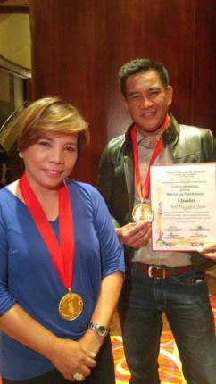 """GMA News TV_s I Juander was hailed as """"Best Magazine Show"""". Hosts Susan Enriquez and Cesar Apolinario accepted the award"""