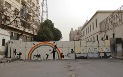 One mural depicts silhouettes of children and families.  Image on a CC license by Mosa'ab Elshamy.