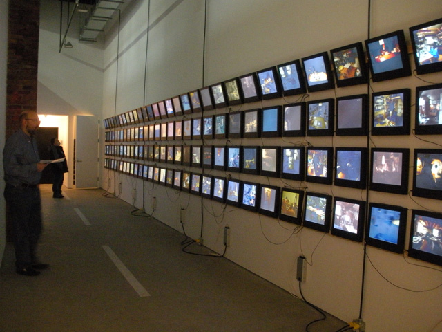 """Videos by Dieter Roth on the wall, Mary Heilmann's """"Two-Lane Highway"""" on the floor"""