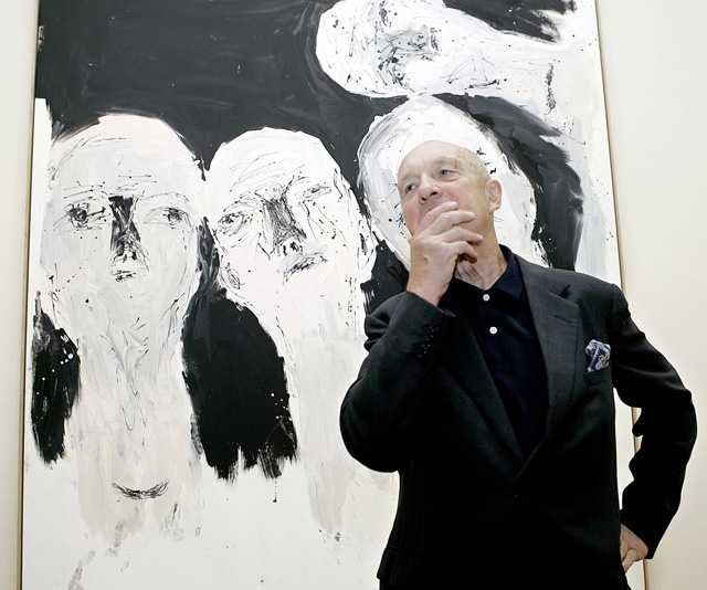 Georg Baselitz in front of one of his paintings (image via fansiter.com)