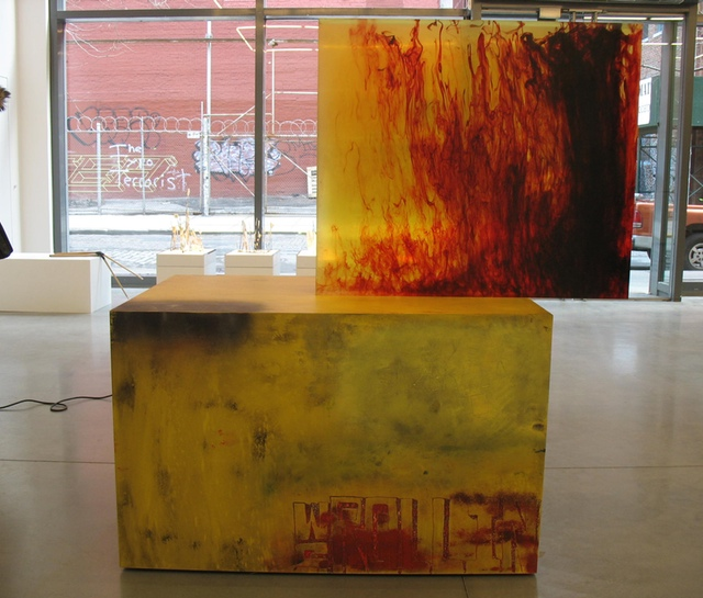 """Sterling Ruby """"ACTS/WS ROLLIN"""" (2011). Clear urethane block, dye, woodand formica, 50.5 x 62.5 x 34 inches."""