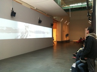 Visitors watch Xu Bing's The Character of Characters, an animated short. Photo by the author.