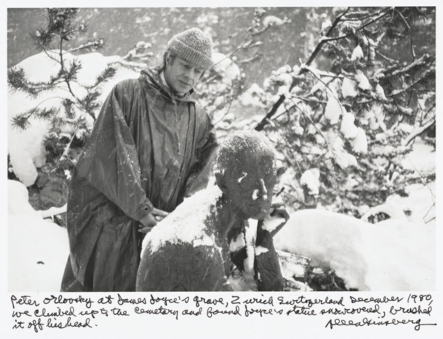 """Allen Ginsberg, """"Peter Orlovsky at James Joyce's grave, Zurich Switzerland December 1980, we climbed up the cemetery and found Joyce's statue snowcovered, brushed it off his head."""" (1980), gelatin silver print, printed 1984–97, 7 1/2 x 11 1/4 in. Collection of Gary S. Davis (© 2012 Allen Ginsberg LLC, all rights reserved)"""