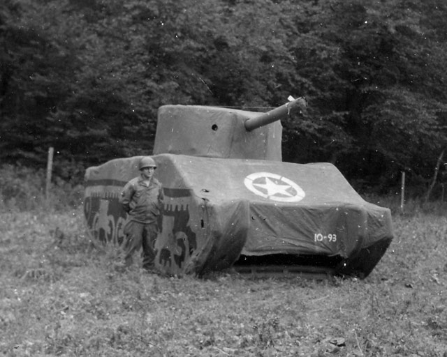 A Ghost Army soldier stands next to a rubber M4 Sherman tank, 93 pounds fully inflated. (image courtesy the National Archives and PBS)