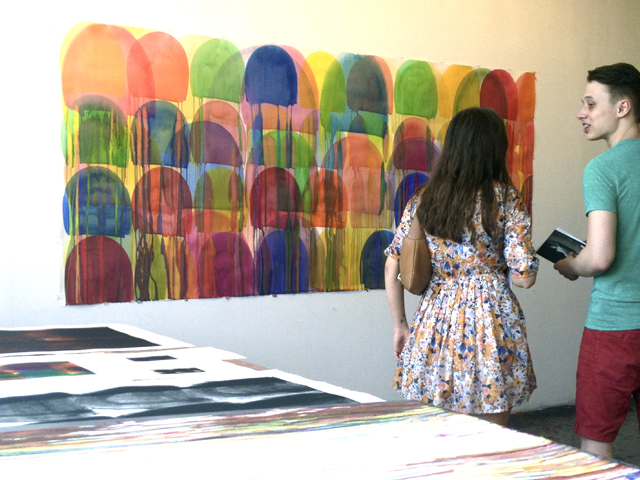 Viewers discuss an untitled watercolor from 2013 by Svetlana Rabey at Bushwick Open Studios.