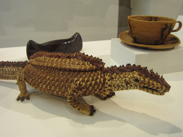 "Maggie Poncho, ""Alligator-shaped Effigy Baskey"" (1962), pine cone, pine needles, cotton fabric"