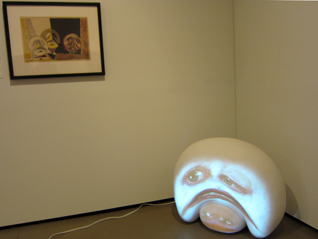"Max Ernst, ""Masques (Spies and Leppien 49)"" (195), color lithograph; Tony Oursler, ""Swathe"" (2004), fiberglass sculpture, 2 DVDs, Sony projector, DVD player"