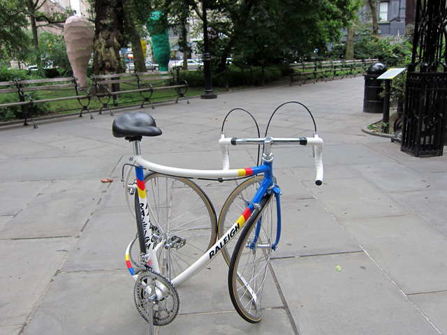 """Alicja Kwade, """"Journey without Arrival (Raleigh)"""" (2012/2013), stainless steel, aluminum, rubber, plastic components found materials distorted. dismantled and reassembled bicyle with bent pieces into a circle"""