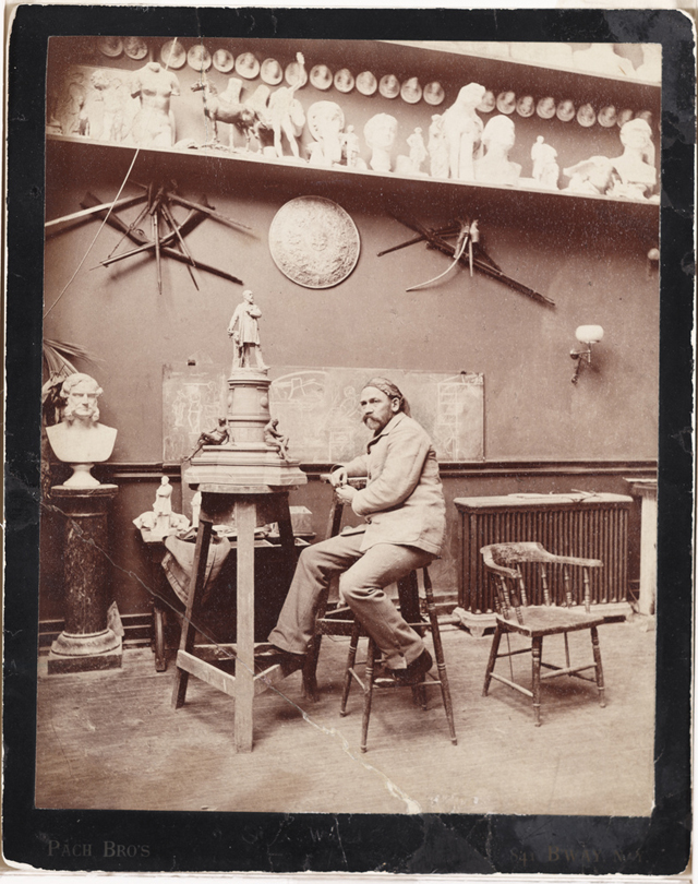 John Quincy Adams Ward in his studio (ca. 1887) (photograph by Pach Brothers, via Smithsonian Institution)