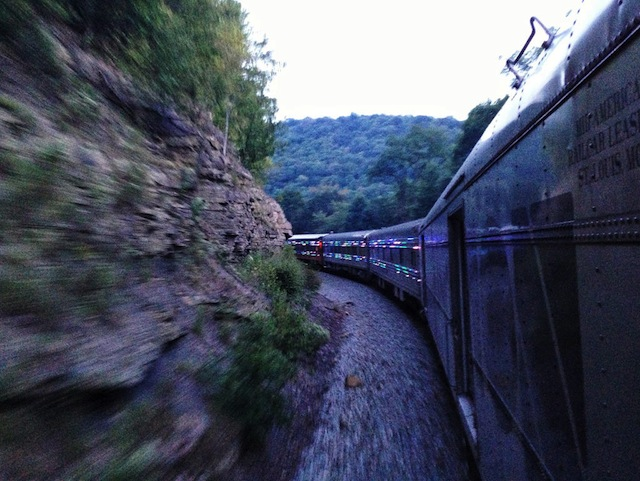 The train rounds a corner.