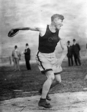 Jim Thorpe competing in the discus as part of the decathlon in the 1912 Summer Olympics in Stockholm (via Wikimedia)