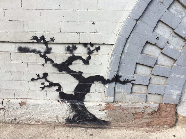 A detail of the Graham Avenue Banksy