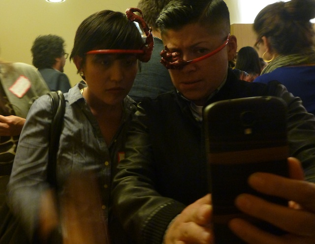 Thea Tagle and Raquel Gutiérrez pose with their Manananggoogle Glasses. Image by the author for Hyperallergic.