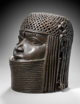 "This work by an unidentified artist, ""Commemorative head of a king (Oba),"" Edo peoples, Benin kingdom, Nigeria (late 16th century), copper alloy, iron, 9 1/2 x 6 1/2 in (24.1 x 16.5 cm), is currently on view at the Museum of Fine Arts, Boston, but Nigeria wants it back. (image via mfa.org)"