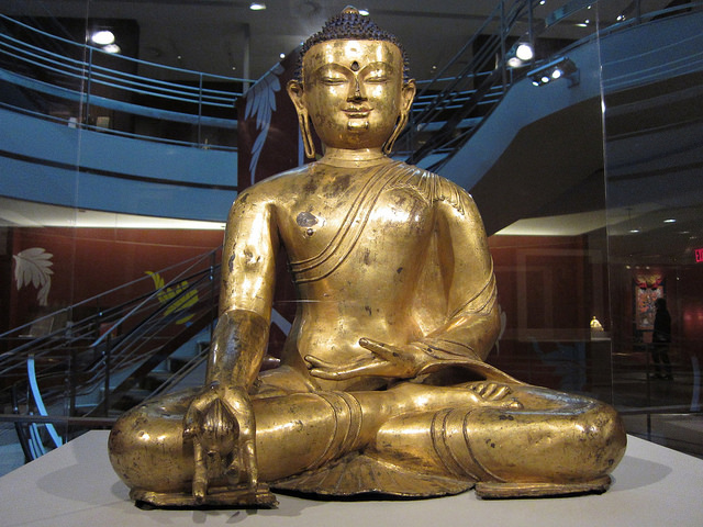 """Medicine Buddha Bhaishajyaguru"" (14th or early 15th century), gilded and painted copper, Central Tibet"