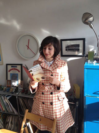 Artist Miriam Elia with a copy of 'We Go to the Gallery' (via miriamelia.co.uk)