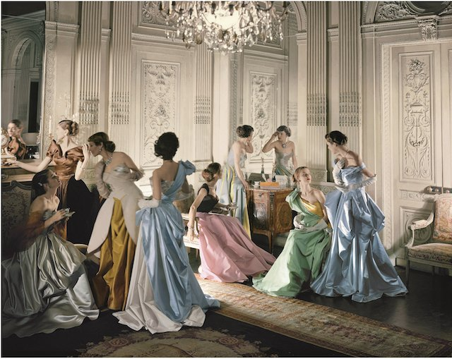 Eight models wearing Charles James gowns, in French & Company's eighteenth century French paneled room