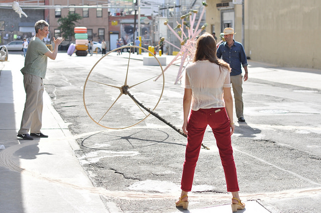 Visitors playing with a sculpture that was part of REAL on Rock Street.