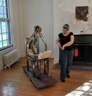 A visitor to last year's Governors Island Art Fair checking out a sculpture by Brian Fernandes-Halloran (photo by Hrag Vartanian/Hyperallergic)
