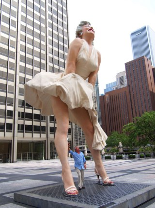 "A man poses tastefully with Seward Johnson's ""Forever Marilyn"" in Chicago (photo by John Picken Photography, via Flickr) (click to enlarge)"