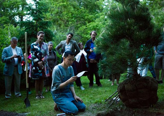 Terence Koh reading a haiku at the dedication of his