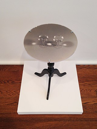 "Robert Watts, ""Table with Two Wine Glasses"" (1965), black and white photograph, Plexiglas disc, mounted on table, unique, 14"" diameter"