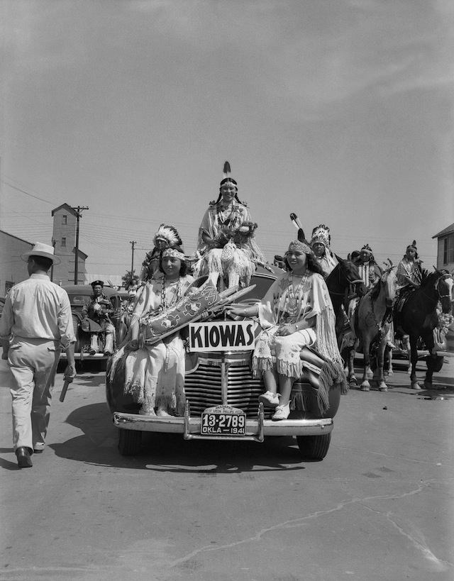 Caption: Left to right: Juanita Daugomah Ahtone (Kiowa), Evalou Ware Russell (center), Kiowa Tribal Princess, and Augustine Campbell Barsh (Kiowa) in the American Indian Exposition parade. Anadarko, Oklahoma, 1941. 45EP9 Tom Jones 2 1/2 hours of cleaning