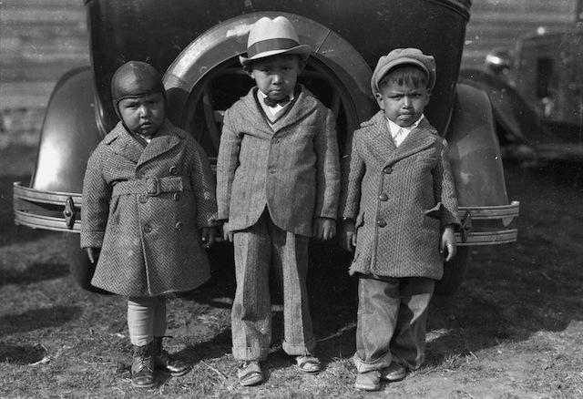 """Caption: Left to right: Newton Poolaw (Kiowa), Jerry Poolaw (Kiowa), Elmer Thomas """"Buddy"""" Saunkeah (Kiowa). Mountain View, Oklahoma, ca. 1928. 57FK1"""