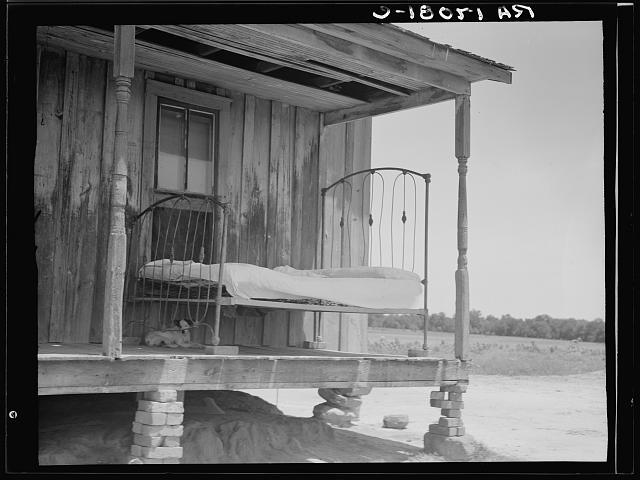 Bed on the porch, Newport, Oklahoma, photograph by Dorothea Lange (June 1937) (via Photogrammar/Library of Congress)