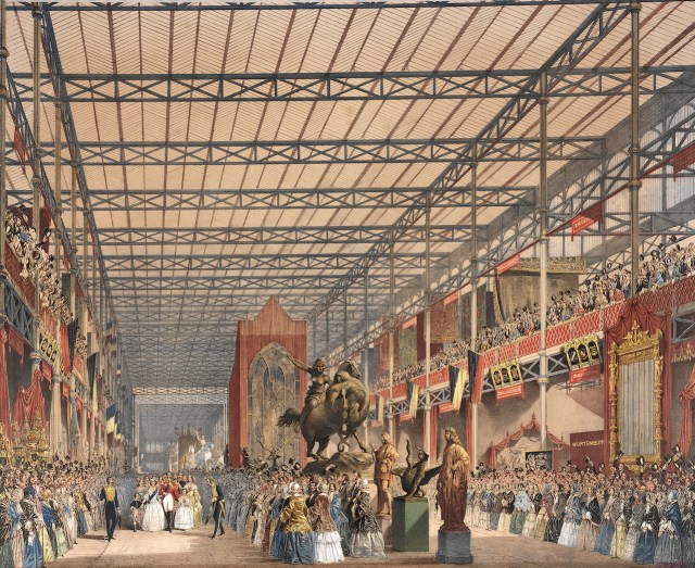 """In """"Royal Tour of Inspection,"""" a lithograph printed in 1854 by the Dickinson Brothers, Queen Victoria and Prince Albert walk in the Crystal Palace, where the Great Exhibition displayed manufactured products from around the world in 1851. The monarchs are depicted small to emphasize their grand accomplishment."""