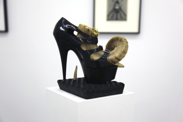 """BREYER P-ORRIDGE, """"Shoe Horn #3"""" (2014),  ram horn, shoe worn by Genesis as """"Lady Sarah"""" (he/r dominatrix persona), sting ray skin, ermine fur, bone, Nepalese fabric-printing square, brass netting, copper ball, 9.25 x 9 x 8 in (courtesy the artists and Invisible-Exports)"""