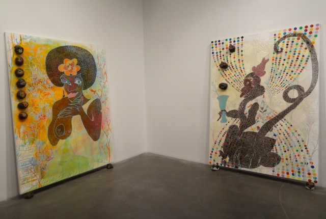 """Installation view of 'Chris Ofili: Night and Day' with """"Blossom"""" (1997, at left) and """"Monkey Magic - Sex, Money and Drugs"""" (1999, at right)"""
