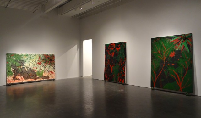 """Installation view of 'Chris Ofili: Night and Day' with """"Triple Beam Dreamer"""" (2001–02, at left), """"Afro Green"""" (2005–08, at center), and """"Afro Jezebel"""" (2002–03, at right)"""