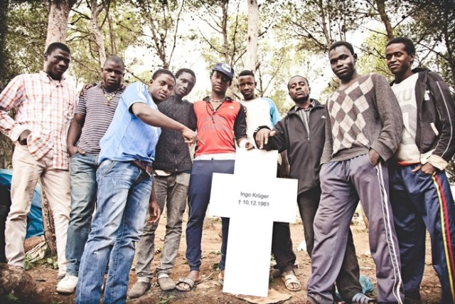 Migrants in Melilla pose with one of the crosses (Image courtesy of the Center for Political Beauty)